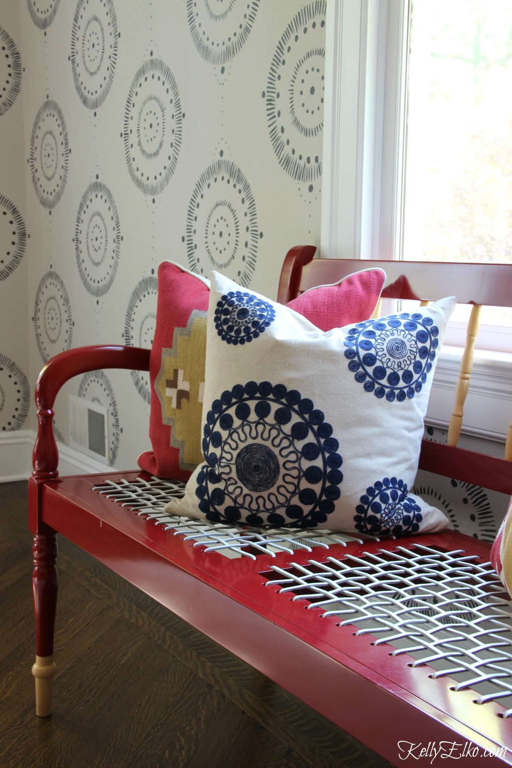 Forget wallpaper! This hand painted mural is like faux wallpaper minus the expense an I love the red lacquer bench with woven seat kellyelko.com #bench #wallpaper #mural #diningroom #wallart #handpainted