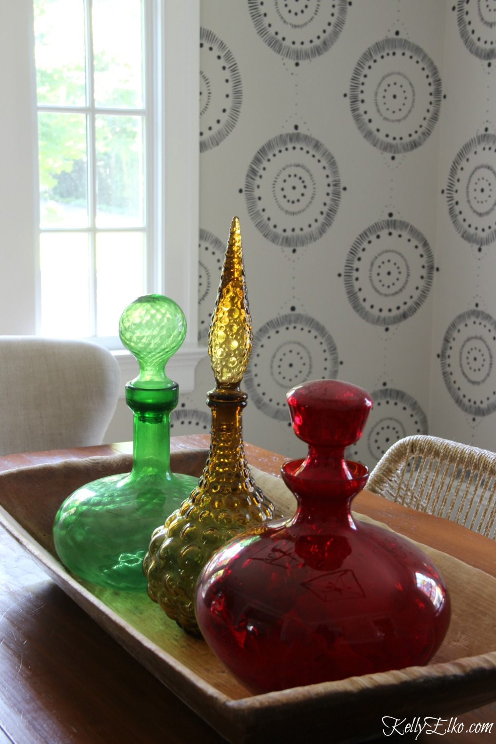 Forget wallpaper! This hand painted mural is like faux wallpaper minus the expense and I love the mid century decanters in an old dough bowl kellyelko.com #wallpaper #mural #diningroom #wallart #handpainted