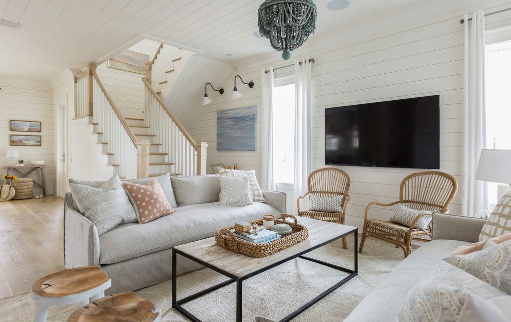 What a gorgeous home! Love the neutral family room with blue beaded chandelier and the texture from natural wood and rattan kellyelko.com #housetour #homedecor #familyroom #coastalstyle #decorate #interiors