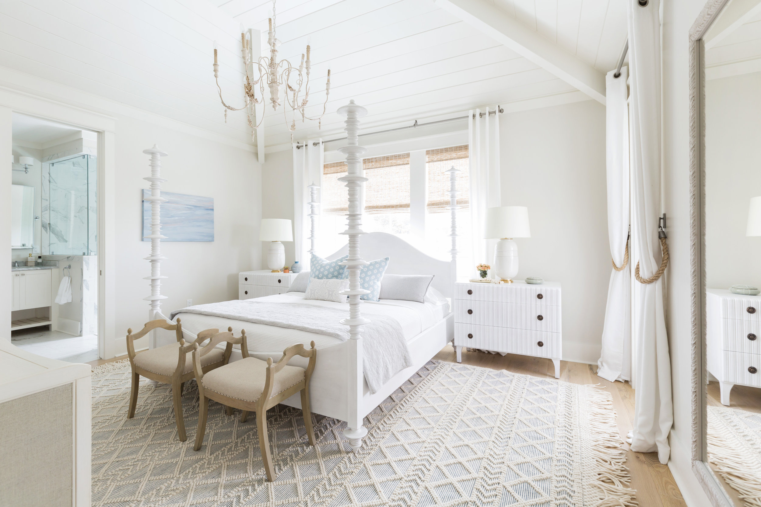 Love this neutral master bedroom with four poster bed, ornate chandelier and textured rug kellyelko.com #bedrooms #bedroomdecor #decorate