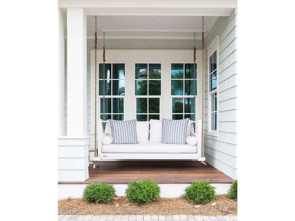Beautiful home tour of this coastal home with hanging porch swing kellyelko.com #porch #porchdecor #farmhousestyle