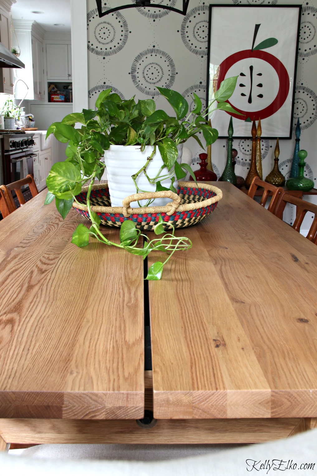 Love this solid oak dining table that's extendable to seat 12! kellyelko.com #diningroom #diningtable #diningroomfurniture #mural #centerpiece