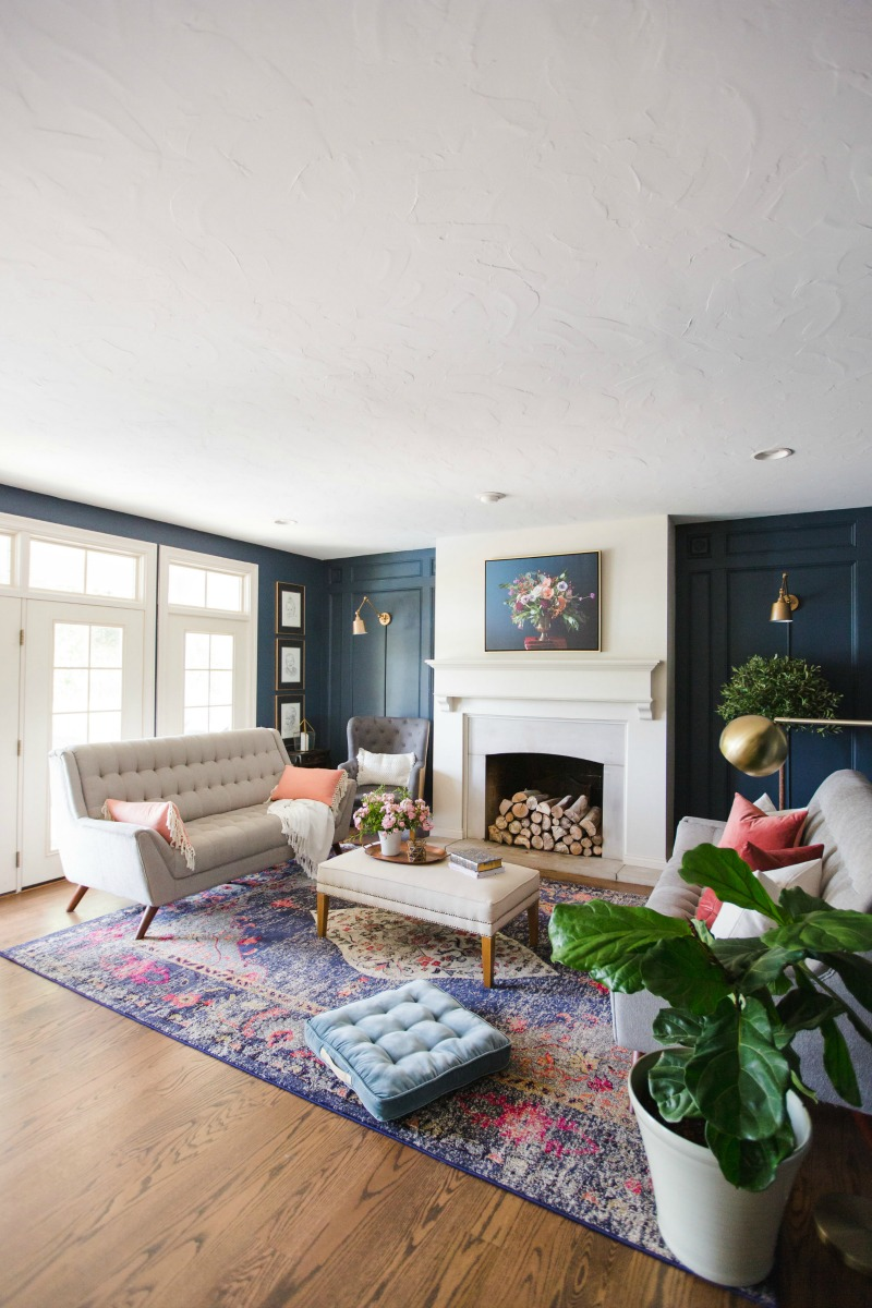 Love this blue living room with colorful rug kellyelko.com #livingroomdecor #familyroomdecor #bluepaint #eclecticstyle #interiordecorate #interiordecor