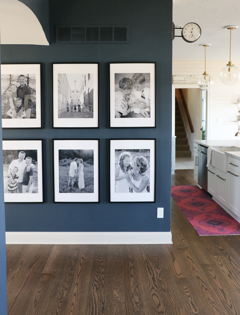 Eclectic Home Tour complete with oversized family gallery wall on dark blue walls kellyelko.com #blue #gallerywalls #familyphotos #hometour