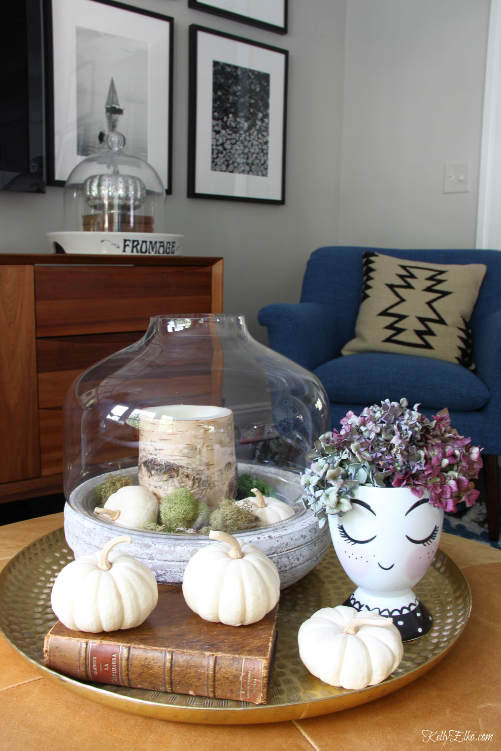 Simple Fall Touches - love this huge brass tray with terrarium of moss and pumpkins and the head vase with hydrangeas kellyelko.com #fall #falldecor #falldecorating #interiordecor #pumpkins #hydrangeas #eclecticstyle #autumndecor