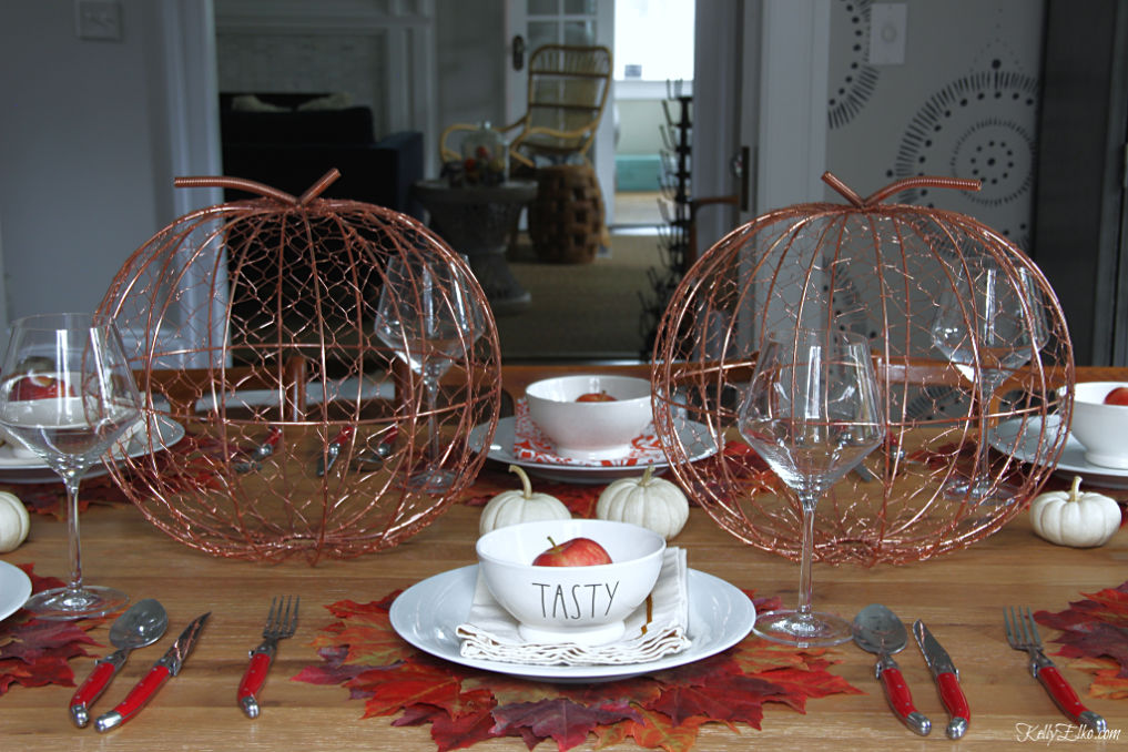 What a fabulous fall leaves tablescape with mixed metals, Rae Dunn bowls and copper pumpkins kellyelko.com #fall #falltablescape #falldecor #fallleaves #thanksgiving #thanksgivingtable #tablescape #diningroom