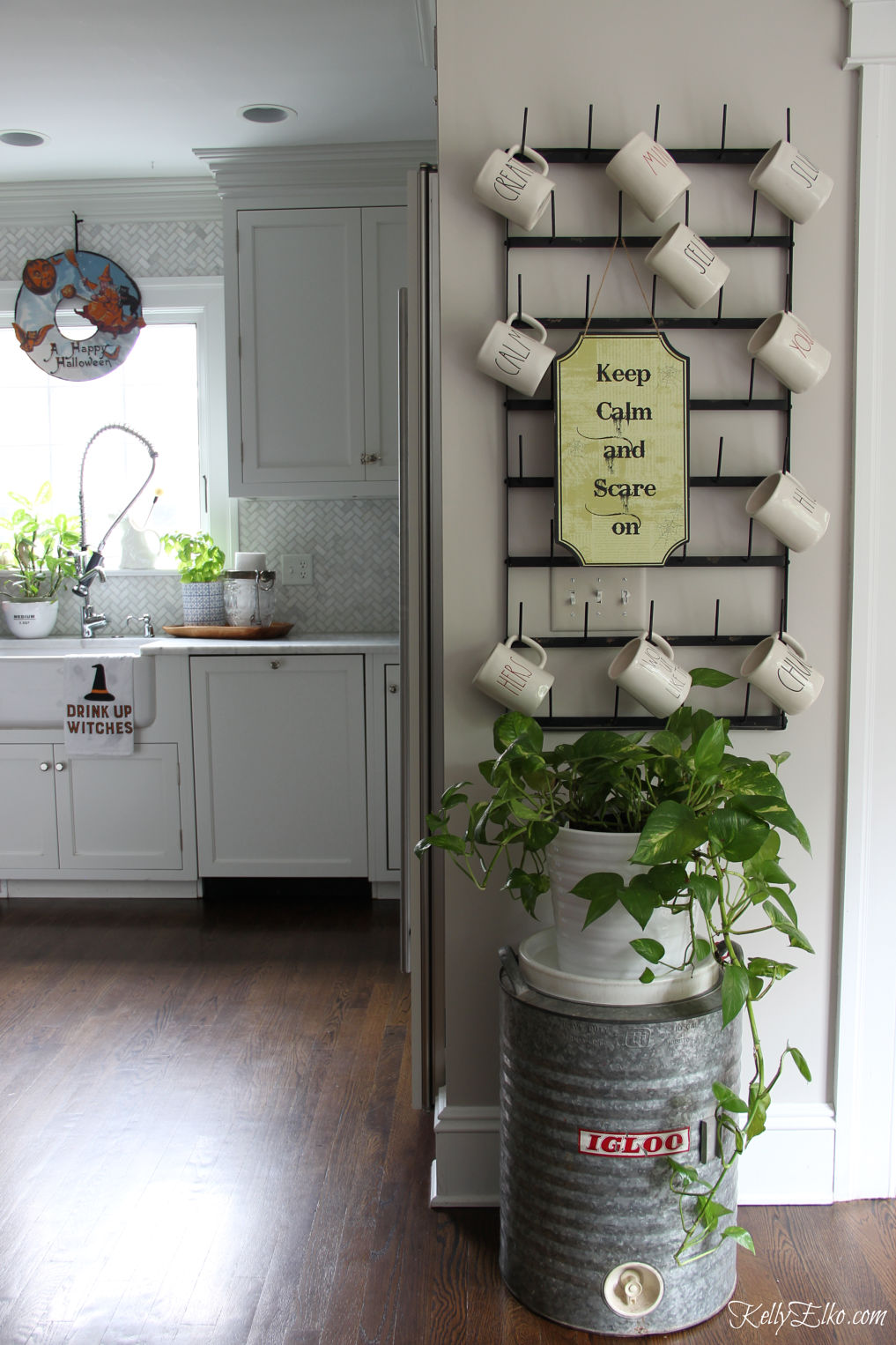 Halloween home tour - love the huge bottle drying rack and Halloween signs kellyelko.com #halloween #halloweendecor #halloweendecorations #farmhousestyle
