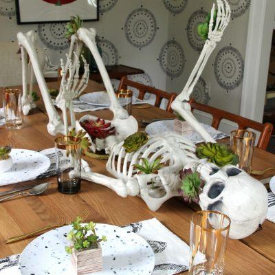 Halloween Succulent Skeleton Centerpiece kellyelko.com #halloween #halloweendecor #halloweentable #halloweentablescape #skeleton #succulents