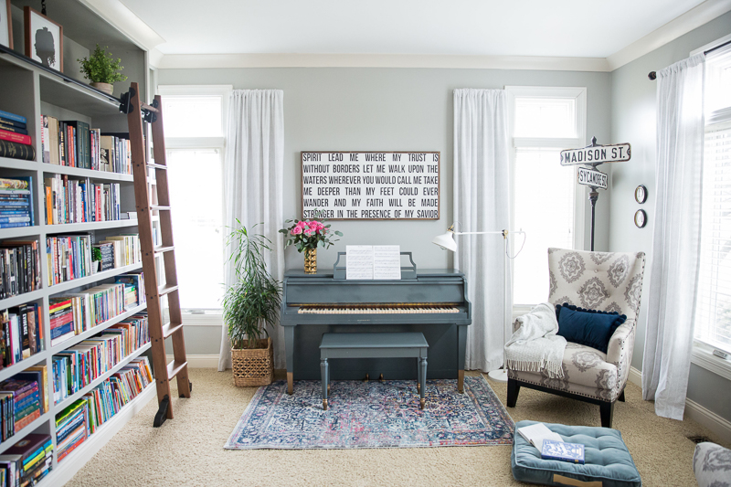 Colorful home tour - love the built in bookcase with rolling library ladder kellyelko.com #bookcase #library #diyideas #homeoffice #bookshelves
