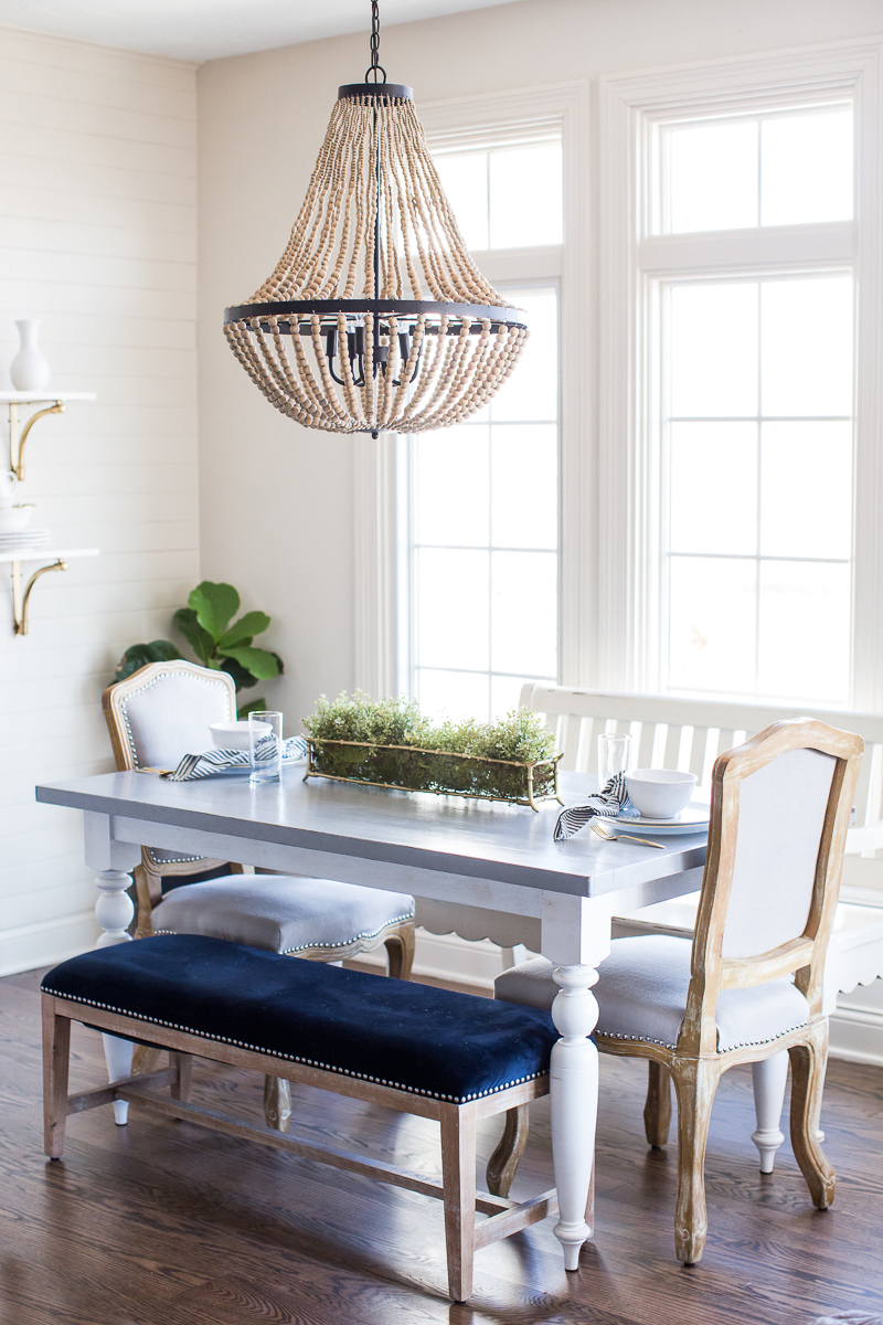 Love this eat in breakfast nook with beaded chandelier and mismatched chairs kellyelko.com #kitchen #kitchendecor #farmhousekitchen #kitchenfurniture #lighting #chandelier
