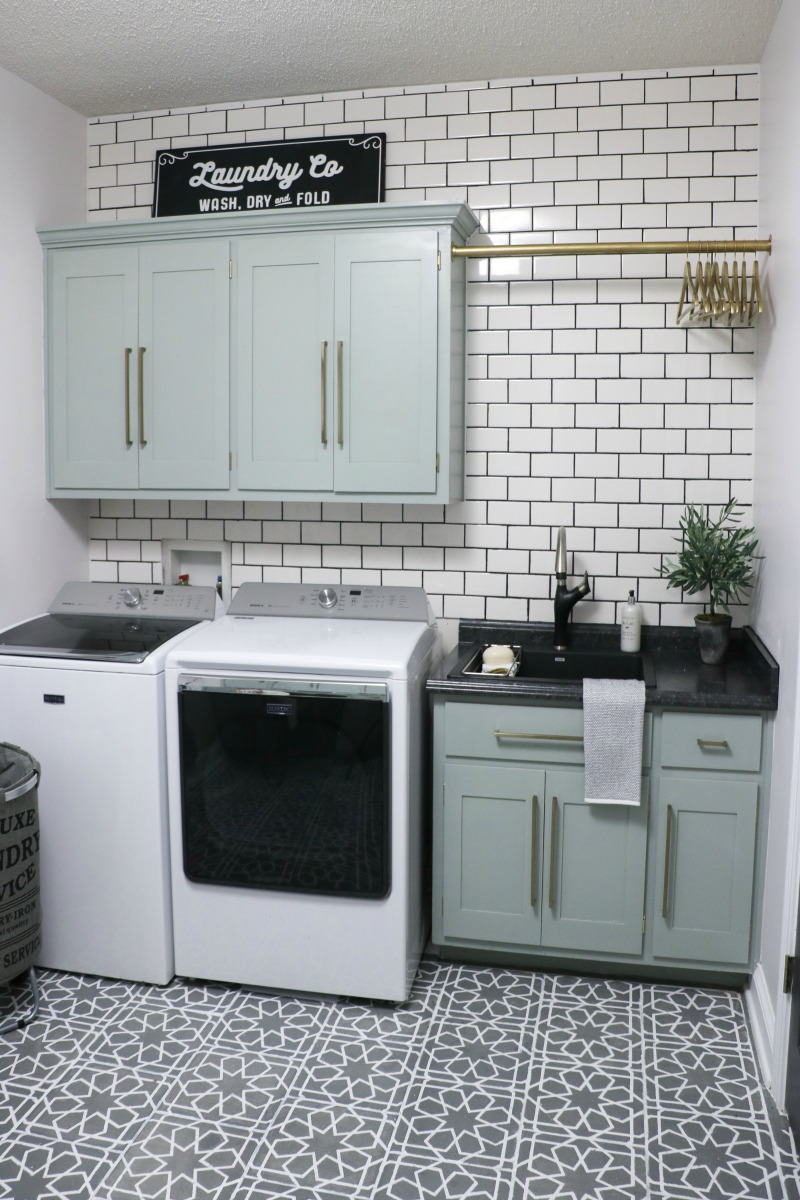 Beautiful laundry room with subway tile backsplash and stenciled tile floor kellyelko.com #laundryroom #diyideas #stencil #interiordecor