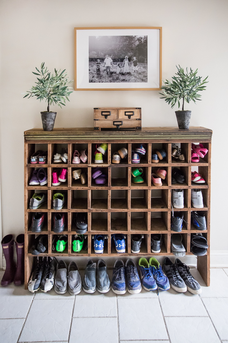 Love this antique mail sorter turned shoe storage in this mudroom kellyelko.com #mudroom #repurpose #thrifted #antique #shoestorage