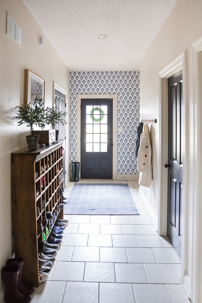Love this back entry mudroom with blue wallpaper kellyelko.com #mudroom #blue #wallpaper #vintagedecor #farmhousestyle #interiors #interiordecor