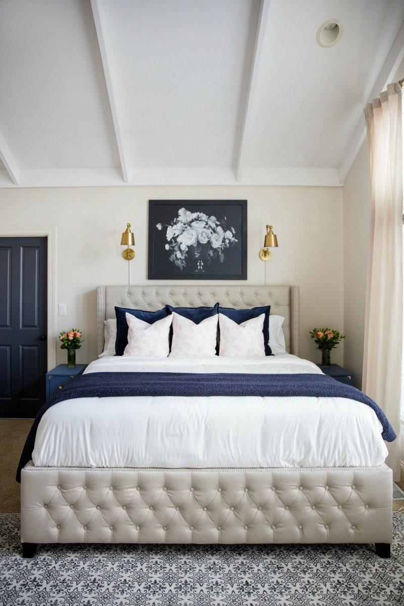 Master bedroom with blue and white accents kellyelko.com #masterbedroom #bedroom #bedroomdecor #lighting #sconces #interiordecor #beds