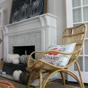Chalkboard Pumpkin Mantel - love the way she decorated the hearth with an abundance of neutral pumpkins and the chalkboard art is beautiful kellyelko.com #fall #falldecor #fallmantel #chalkboardart #falldecor #pumpkins