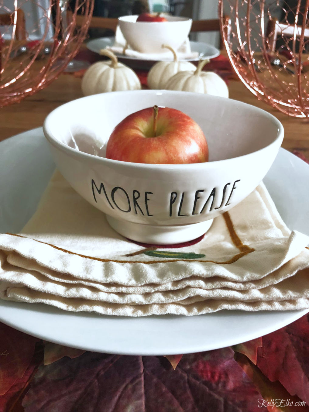 Love these Rae Dunn bowls on a fall tablescape kellyelko.com #fall #falltablescape #raedunn #falldecor #fallleaves #thanksgiving #thanksgivingtable #tablescape #diningroom