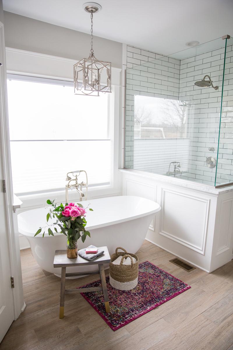 Beautiful bathroom with freestanding tub and subway tile kellyelko.com #bathroom #masterbathroom #bathtub #subwaytile #bathroomrenovation