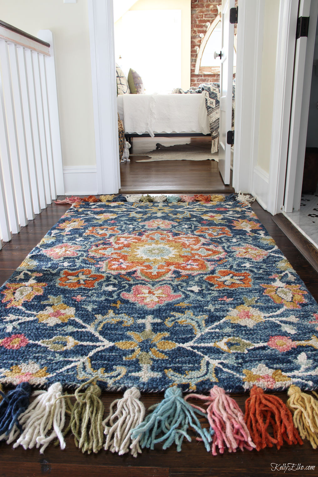 Guest Bedroom Decor - love this colorful rug with huge tassels kellyelko.com #bedroom #bedroomdecor #bedroomfurniture #bedroomdecorating #guestbedroom #rugs #loloi #bohodecor