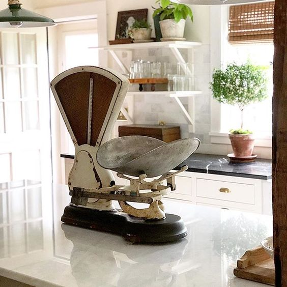 Eclectic Home Tour of The Cobbler Shop on Concord - love the antique scale on the kitchen counter kellyelko.com #farmhouse #farmhousedecor #interiordecor #interiordecorate #antiques #cottagestyle #hometour #housetour