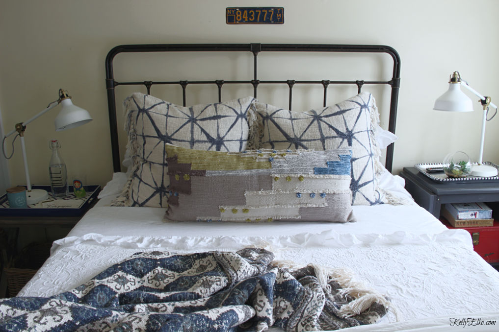 Guest Bedroom Decor - love the iron bed and white bedding with lots of fun, colorful pillows kellyelko.com #bedroom #bedroomdecor #bedroomfurniture #bedroomdecorating #guestbedroom #bedding