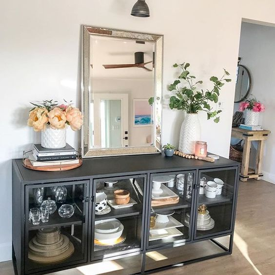 Eclectic Home Tour 1111 Light Lane - love this black metal console in the dining room kellyelko.com #diningroom #diningroomdecor #industrialstyle #eclecticstyle #interiordecor #interiordecorate