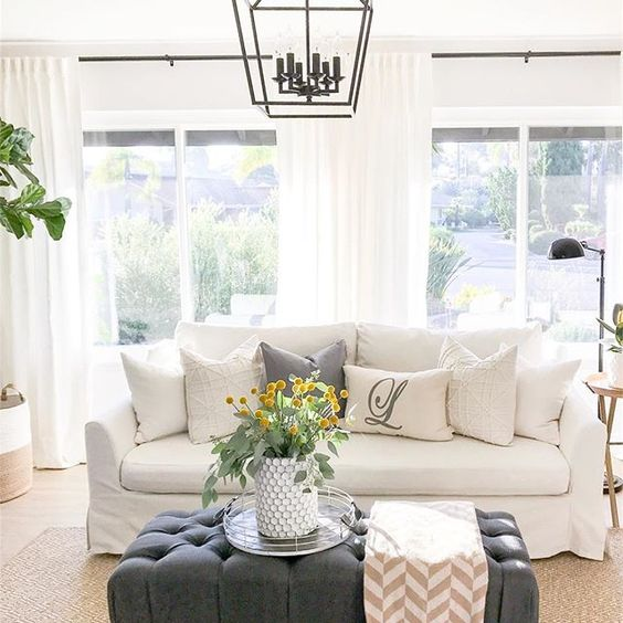 Eclectic Home Tour 1111 Light Lane - love the white slipcovered sofa and gray ottoman in this cottage kellyelko.com #slipcoveredsofa #neutraldecor #familyroom #familyroomdecor #ottoman #lighting #lanterns
