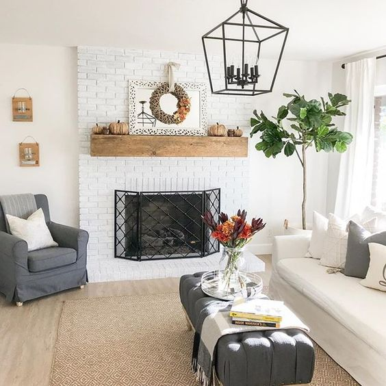 Eclectic Home Tour 1111 Light Lane - love the white painted brick fireplace in this charming cottage kellyelko.com #fireplace #mantel #brickfireplace #paintedbrick #familyroom #cottagestyle #farmhousestyle #neutraldecor