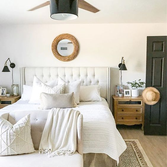 Eclectic Home Tour 1111 Light Lane - love this neutral farmhouse master bedroom with upholstered bed kellyelko.com #bedroom #masterbedroom #neutraldecor #whitebedroom #lighting #cottagestyle #farmhousestyle #farmhousedecor #cottagedecor