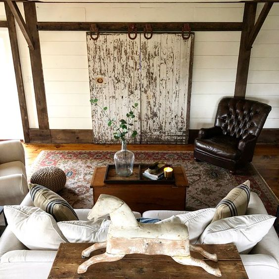 Eclectic Home Tour of The Cobbler Shop on Concord - love the DIY rolling barn doors to hide a tv kellyelko.com #farmhouse #farmhousedecor #interiordecor #interiordecorate #cottagestyle #hometour #housetour #diyideas #barndoors