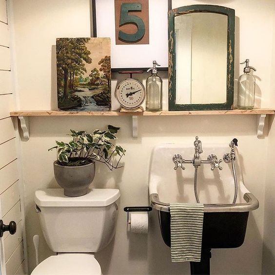 Eclectic Home Tour of The Cobbler Shop on Concord - love the sink that looks like an antique and the open shelf for display kellyelko.com #farmhouse #farmhousedecor #interiordecor #interiordecorate #bathroom #bathroomdecor #antique #powderroom #cottagestyle #hometour #housetour