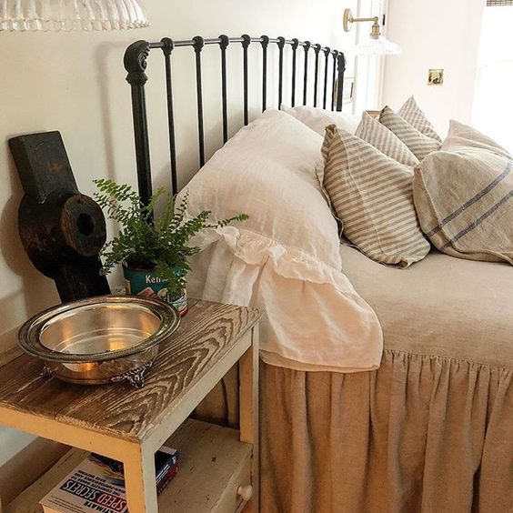Eclectic Home Tour of The Cobbler Shop on Concord - love the iron bed and ruffled bedding kellyelko.com #farmhouse #farmhousedecor #interiordecor #interiordecorate #bedroom #bedroomdecor #cottagestyle #hometour #housetour