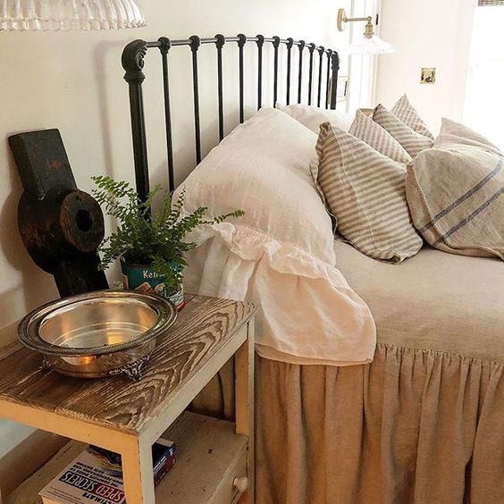 Eclectic Home Tour of The Cobbler Shop on Concord - love the iron bed and ruffled bedding kellyelko.com #farmhouse #farmhousedecor #interiordecor #interiordecorate #bedroom #bedroomdecor #cottagestyle #hometour #housetour