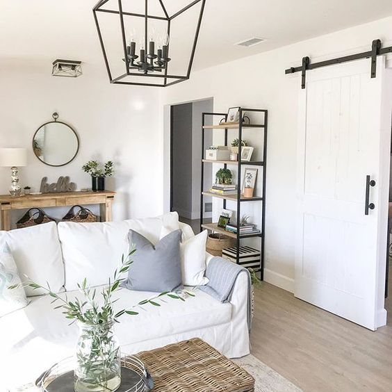 Eclectic Home Tour 1111 Light Lane - love this farmhouse style home and the rolling barn door kellyelko.com #farmhousestyle #cottagestyle #neutraldecor #familyroom #interiordecor #lighting