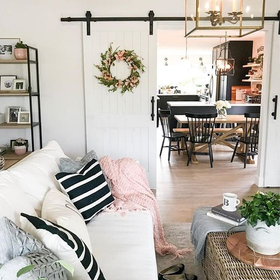 Eclectic Home Tour 1111 Light Lane - love the sliding barn doors in this cottage renovation kellyelko.com #farmhousedecor #cottagedecor #farmhousestyle #cottagestyle #neutraldecor #barndoors #interiodecor