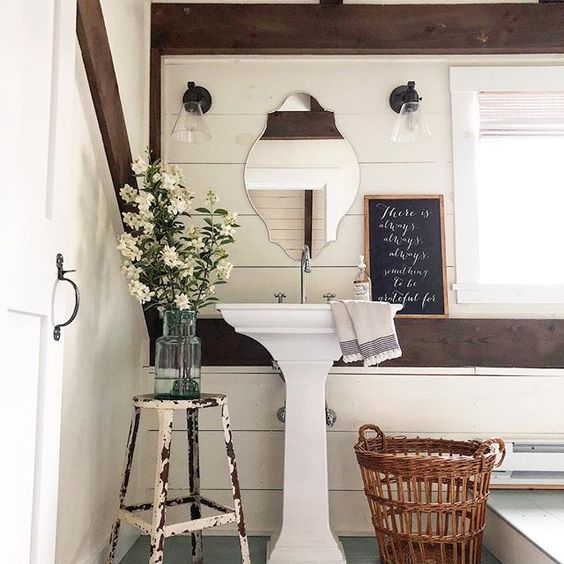 Eclectic Home Tour of The Cobbler Shop on Concord - love this rustic bathroom with shiplap walls and pedestal sink kellyelko.com #farmhouse #farmhousedecor #interiordecor #interiordecorate #bathroom #powderroom #bathroomdecor #shiplap #cottagestyle #hometour #housetour