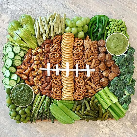 Love this football themed snack board kellyelko.com #football #superbowl #partyfood #appetizers #charcuterie #snackboard #gameday #superbowlrecipes
