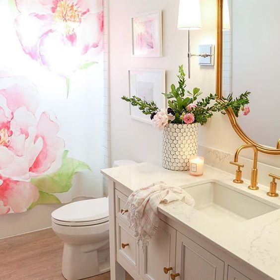 Eclectic Home Tour 1111 Light Lane - love this pink bathroom with floral shower curtain kellyelko.com #bathroom #kidsbathroom #floralbathroom #bathroomdecor #bathroomreno #farmhousedecor #cottagedecor