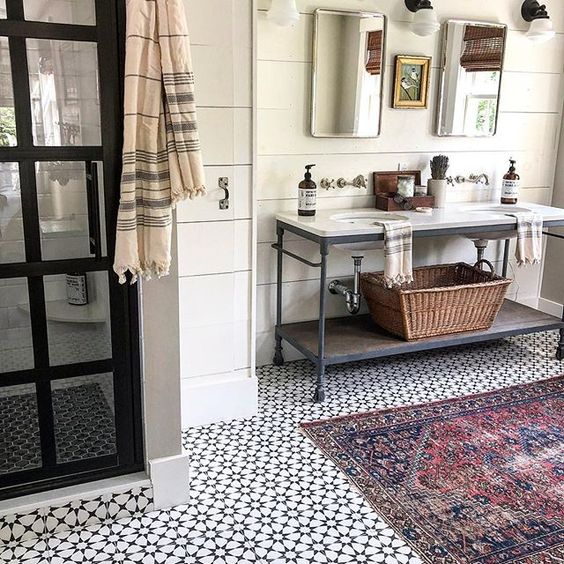 Eclectic Home Tour of The Cobbler Shop on Concord - love the vintage modern bathroom with cement tiles, black shower door and industrial vanity kellyelko.com #farmhouse #farmhousedecor #interiordecor #interiordecorate #bathroom #bathroomdecor #bathroomreno #industrialstyle #vintagemodern #cottagestyle #hometour #housetour