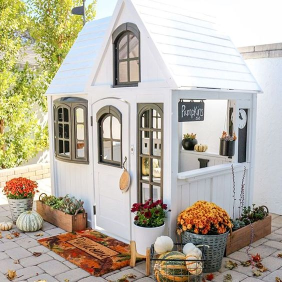 Eclectic Home Tour 1111 Light Lane - love this cute black and white playhouse on the patio kellyelko.com #fall #falldecor #playhouse #cottagestyle #farmhousestyle