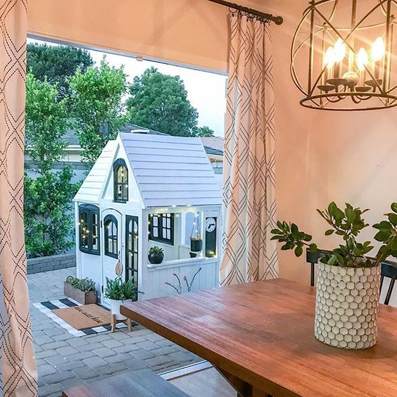 Eclectic Home Tour 1111 Light Lane - love this cute little playhouse outside this cottage kellyelko.com #playhouse #patio #farmhousedecor #cottagedecor