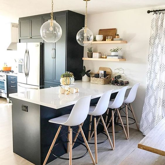Eclectic Home Tour 1111 Light Lane - love this stunning kitchen with black cabinets and wrap around windows kellyelko.com #kitchen #kitchendecor #kitchendesign #kitchenrenovation #blackcabinets #farmhousestyle #cottagestyle