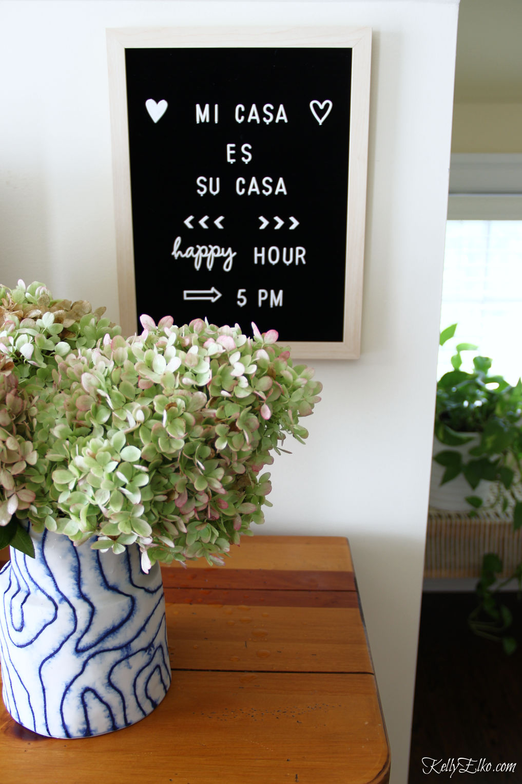 Little details in this guest bedroom include a letter board for adding fun notes kellyelko.com #letterboard #guestbedroom #bedroomdecor #hydrangeas