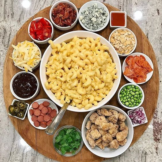 Love this idea for a mac and cheese board with all the mix ins kellyelko.com #macandcheese #comfortfood #appetizers #partyfood #recipes