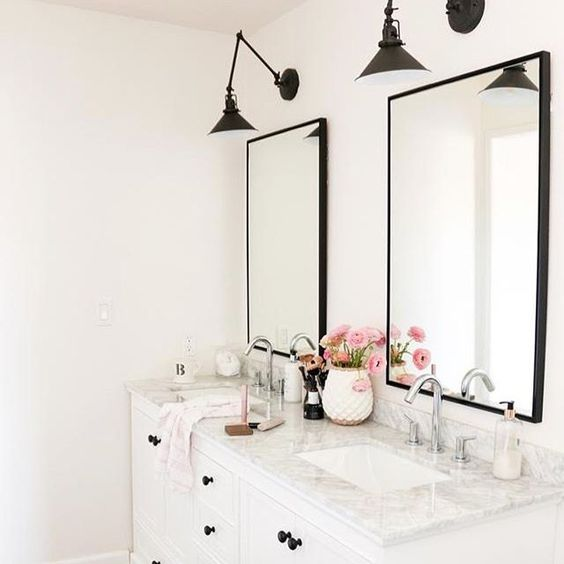Eclectic Home Tour 1111 Light Lane - love this white bathroom with marble counter and black sconces kellyelko.com #bathroom #masterbathroom #doublevanity #sconces #lighting #industrialstyle #blackandwhite #interiordecor