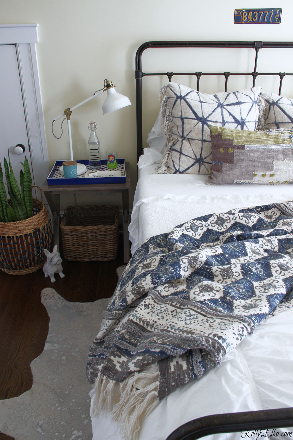 Guest Bedroom Decor - love the iron bed and white bedding with lots of fun pillows and throw kellyelko.com #bedroom #bedroomdecor #bedroomfurniture #bedroomdecorating #guestbedroom #bohodecor #boho