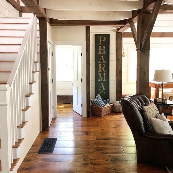 Eclectic Home Tour of The Cobbler Shop on Concord - love the original wood beams and wood floor kellyelko.com #farmhouse #farmhousedecor #interiordecor #interiordecorate #cottagestyle #hometour #housetour #rusticdecor #antiques