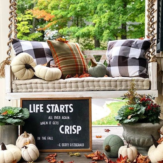 Eclectic Home Tour of The Cobbler Shop on Concord - love this fun fall porch with hanging swing kellyelko.com #farmhouse #farmhousedecor #interiordecor #interiordecorate #fall #falldecor #cottagestyle #hometour #housetour #porch #porchdecor