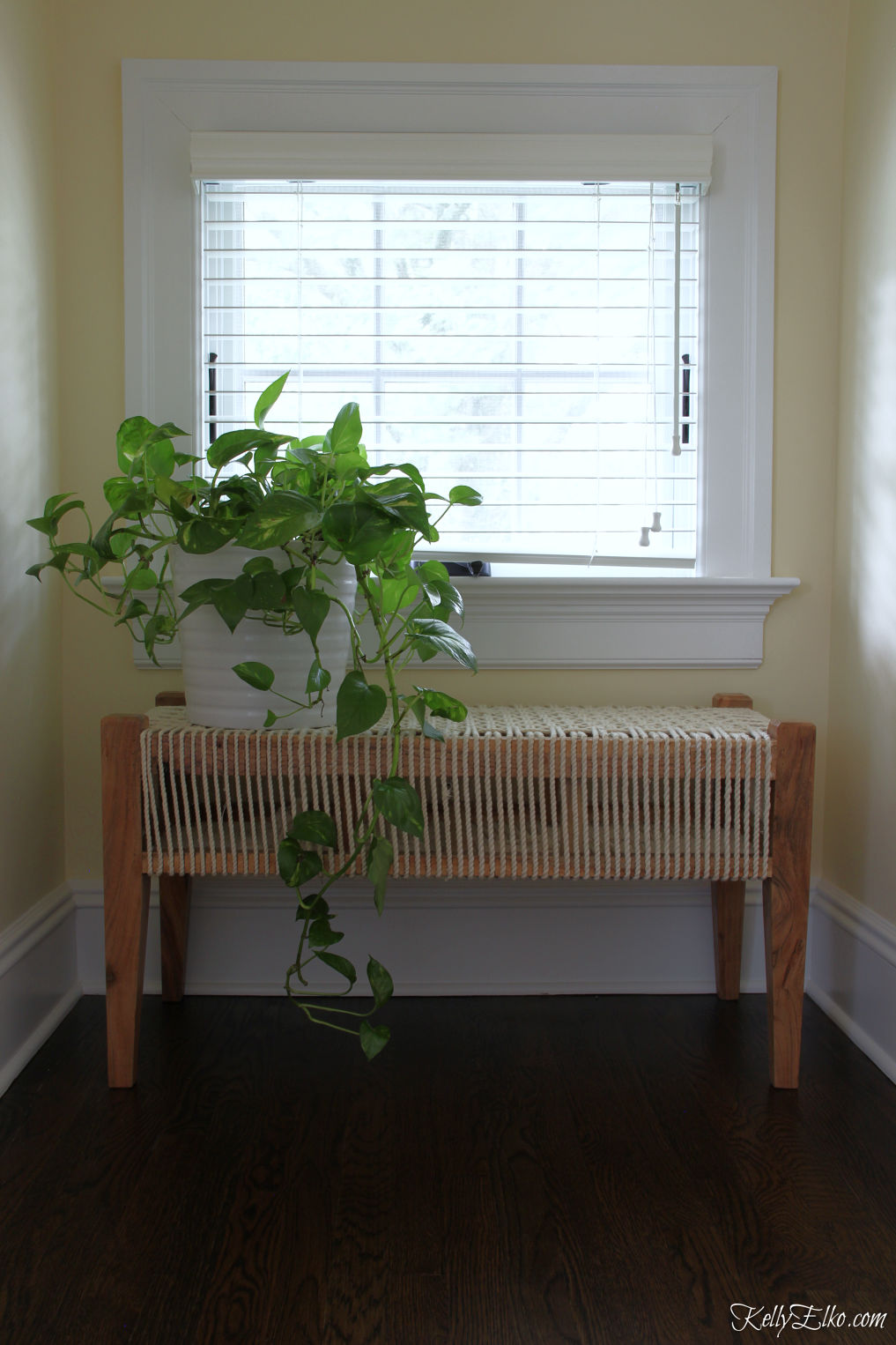 Love this woven rope bench tucked under a window - perfect plant stand kellyelko.com #bohodecor #benches #plants #houseplants