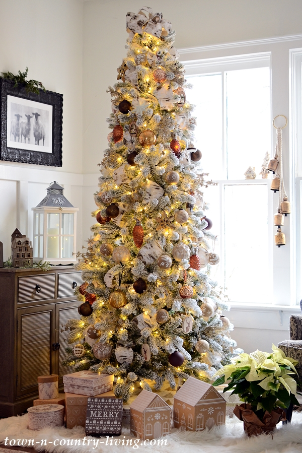 Beautiful Christmas tree and I love the little gingerbread gift boxes under the tree