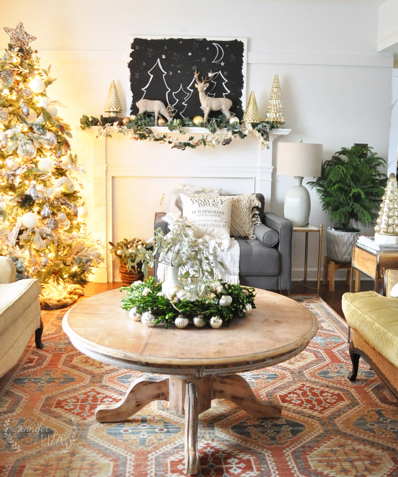 Love this Christmas living room with hand painted black and white starry art on the mantel